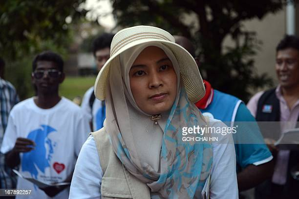 Nurul Izzah daughter of opposition leader Anwar Ibrahim and a member of parliament for Lembah Permai in Kuala Lumpur goes on a walkabout to meet her...