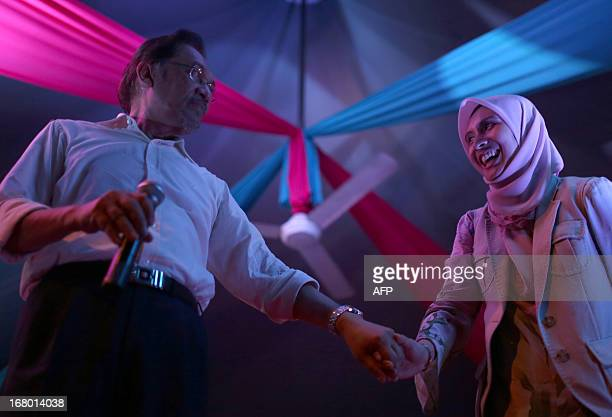 Nurul Izzah daughter of opposition leader Anwar Ibrahim and a member of parliament for Lembah Pantai shares a light moment with her father during...