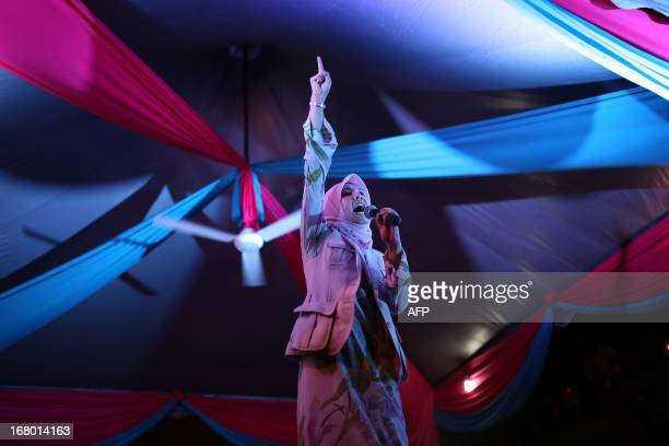 Nurul Izzah daughter of opposition leader Anwar Ibrahim and a member of parliament for Lembah Pantai shouts slogans during her party's campaign event...
