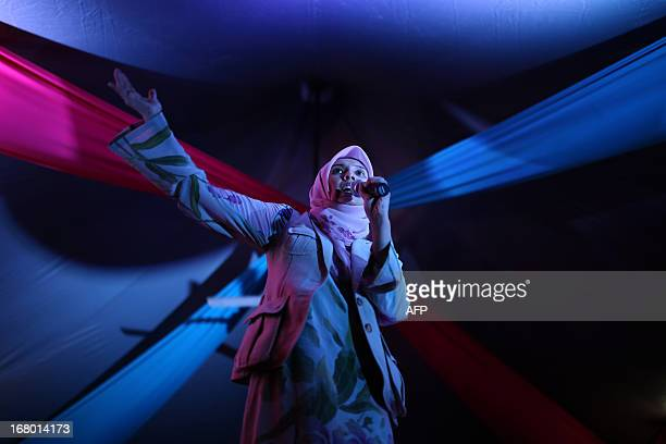 Nurul Izzah daughter of opposition leader Anwar Ibrahim and a member of parliament for Lembah Pantai speaks during her party's campaign event on the...