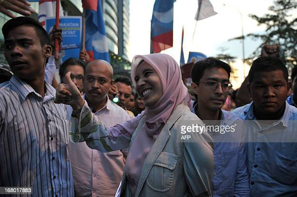 Nurul Izzah daughter of opposition leader Anwar Ibrahim and a member of parliament for Lembah Pantai makes a thumbs up to her supporters during her...