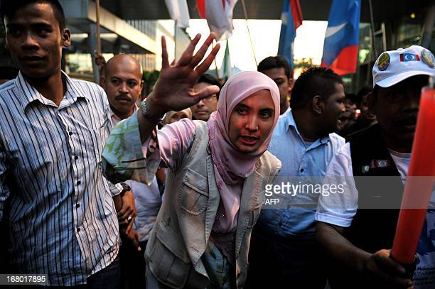 Nurul Izzah daughter of opposition leader Anwar Ibrahim and a member of parliament for Lembah Pantai waves to her supporters during her party's...