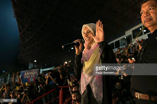 Nurul Izzah daughter of opposition party leader Anwar Ibrahim speaks to his supporters during a late evening postelection rally to protest the...