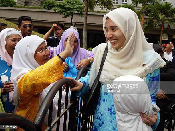 Nurul Izzah the eldest daughter of former Malaysian deputy prime minister Anwar Ibrahim is congratulated bu supporters outside the Palace of Justice...