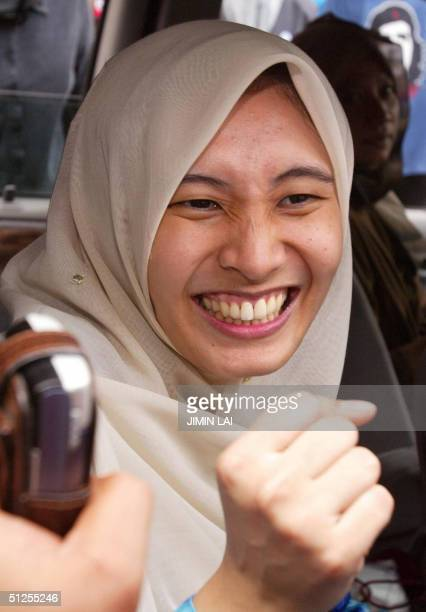 Nurul Izzah the eldest daughter of former Malaysian deputy prime minister Anwar Ibrahim celebrates outside the Palace of Justice courthouse in...