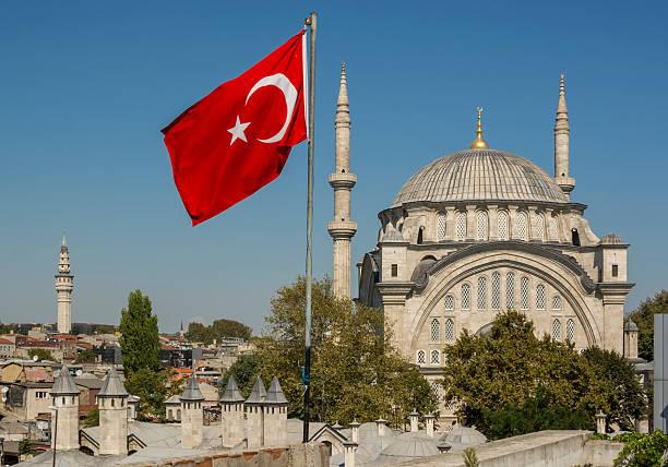 Nuruosmaniye Mosque and turkish flag in Istanbul