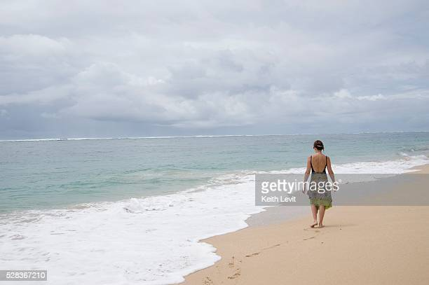 Nusa Dua beach, Nusa Dua, Bali, Indonesia; Woman walking on beach