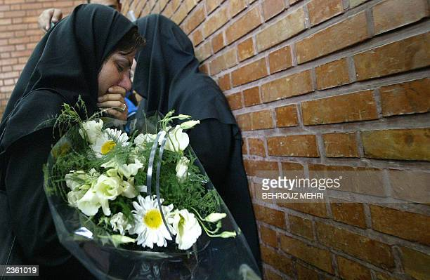 Nushin Mehran a friend of the late Iranian twins Laleh and Ladan Bijani cries as she waits for the arrival of their bodies at Tehran's Mehrabad...