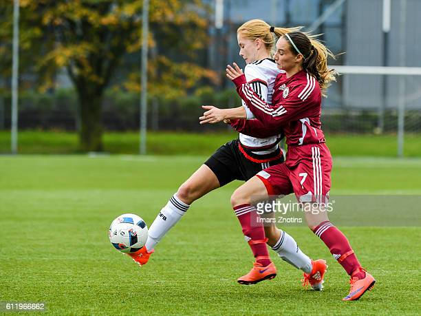 Nusken Sjoeke of Germany is challenged by Valerija Gudkova of Latvia during the UEFA Under17 Girl's Euro Qualifier match Germany and Latvia at Hanza...