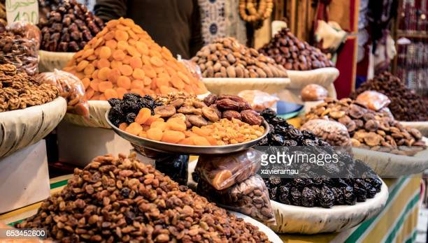 nut store in the streets of fez - nut food stock photos and pictures