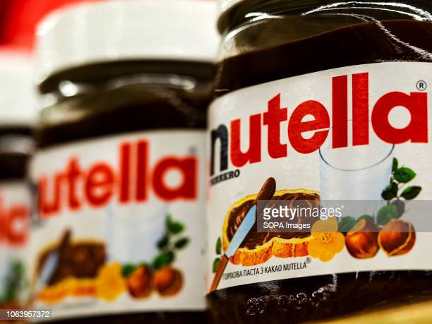 Nutella sweetened palm oil spread flavored with hazelnut and cocoa solids generically called chocolate spread at the store
