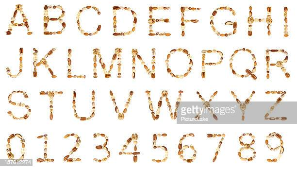 nuts alphabet (uc) and digits - nut food stock photos and pictures
