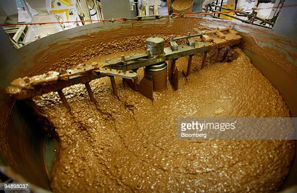 Nuts and raisins are stirred into liquid chocolate during the manufacturing process at the Bournville Cadbury factory in Birmingham UK Tuesday August...