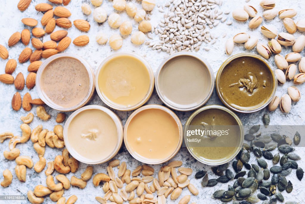 Nuts and seeds butter in glass jars : Stock Photo
