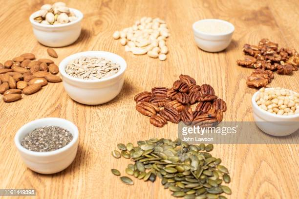 nuts and seeds on a table - 亜鉛 ストックフォトと画像
