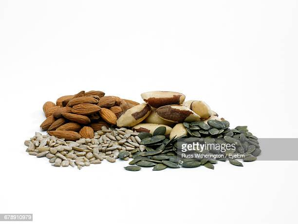 Nuts And Seeds On White Background