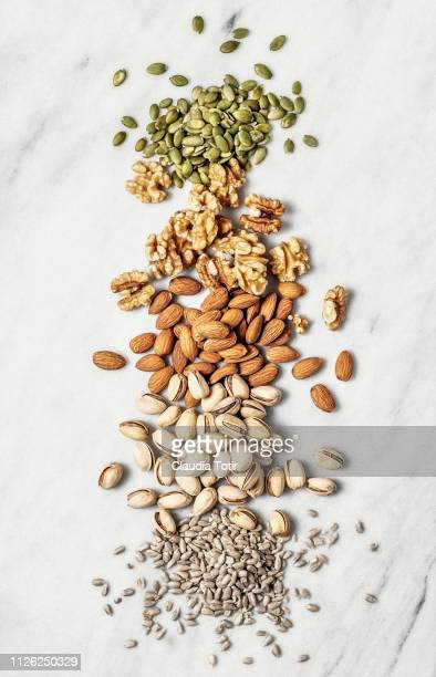 nuts and seeds - seed stock pictures, royalty-free photos & images