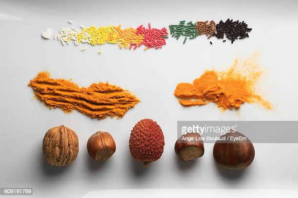 Nuts And Spices Against White Background