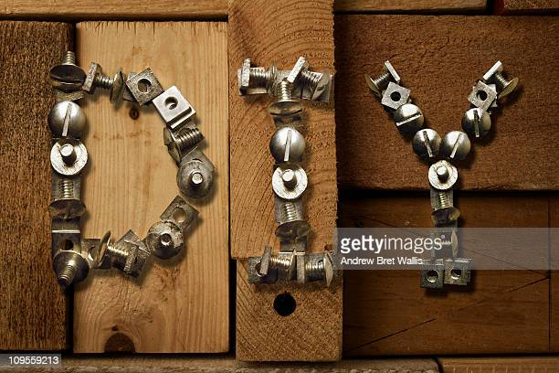 Nuts & bolts spell DIY against timber stack