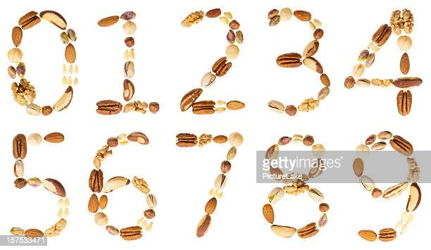 nuts digits (numbers), 0-9 - nut food stock photos and pictures
