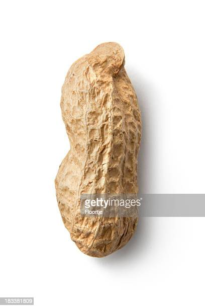 nuts: peanuts isolated on white background - peanuts stockfoto's en -beelden