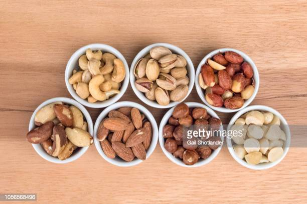 nuts (7 varieties) top down - brazil nut stock photos and pictures