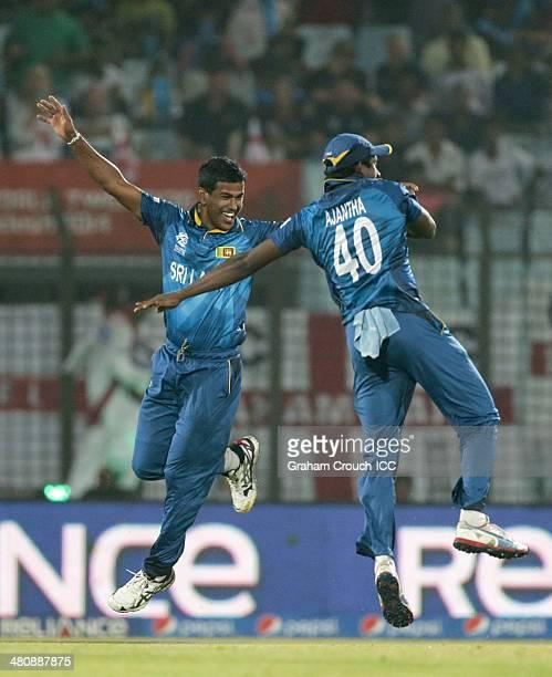 Nuwan Kulasekara of Sri Lanka celebrates with Ajantha Mendis the wicket of Moeen Ali of England during the England v Sri Lanka match at the ICC World...