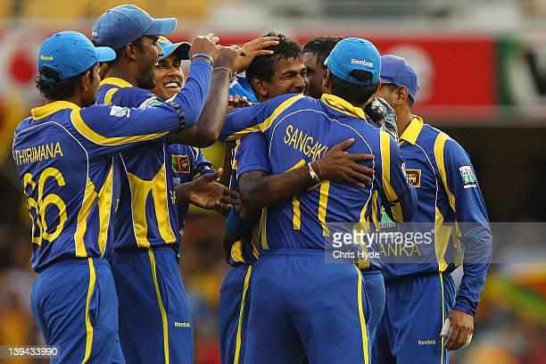 Nuwan Kulasekara of Sri Lanka celebrates with team mates after bowling out Sachin Tendulkar of India during game eight of the One Day International...