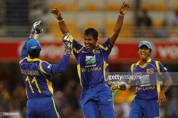 Nuwan Kulasekara of Sri Lanka celebrates with team mates after taking the wicket of Gautam Gambhir of India during game eight of the One Day...