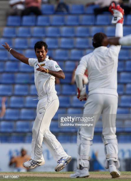 Nuwan Kulasekara of Sri Lanka celebrates with teammate Prasanna Jayawardene after dismIssing Pakistan batsman Taufeeq Umar during day three of the...