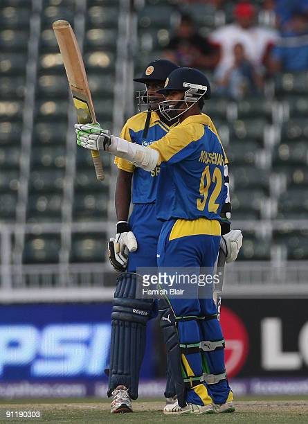 Nuwan Kulasekara of Sri Lanka reaches 50 with team mate Ajantha Mendis looking on during the ICC Champions Trophy Group B match between New Zealand...