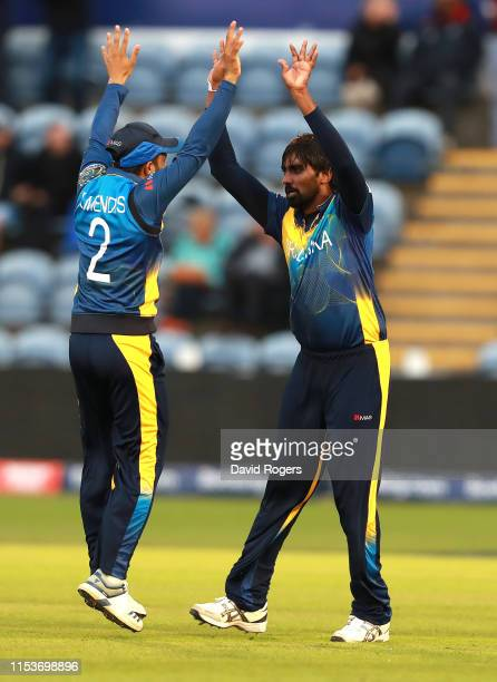Nuwan Pradeep of Sri Lanka celebrates with team mate Kusal Mendis after bowling Rashid Khan during the Group Stage match of the ICC Cricket World Cup...
