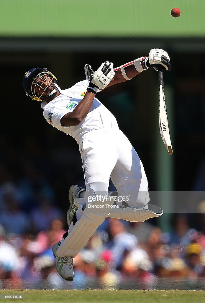 Nuwan Pradeep of Sri Lanka is hit by a bouncer during day four of the Third Test match between Australia and Sri Lanka at the Sydney Cricket Ground on January 6, 2013 in Sydney, Australia.