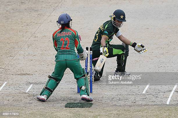 Nuzhat Tasnia of Bangladesh takes out Bismah Maroof of Pakistan during the cricket women's final match between Pakistan and Bangladesh on day seven...