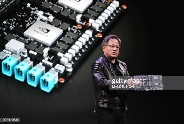 Nvidia CEO Jensen Huang speaks during a press conference at The MGM during CES 2018 in Las Vegas on January 7 2018 / AFP PHOTO / MANDEL NGAN