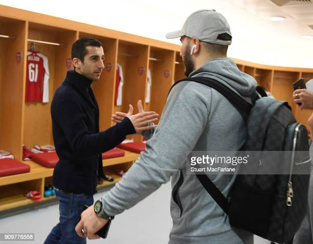 Nw signing Henrikh Mkhitaryan shakes hands with Sead Kolasinac in the Arsenal changing room before the Carabao Cup SemiFinal Second Leg between...