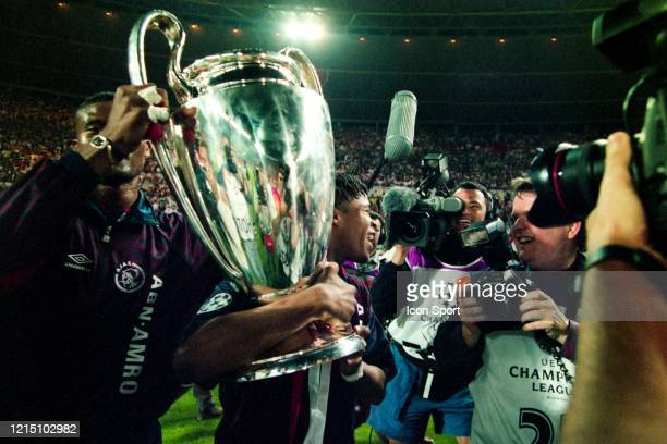 Nwankwo KANU and Edgar DAVIDS of Ajax celebrate the victory with the trophy during the Champions League Final match between Ajax Amsterdam and Milan...