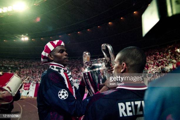 Nwankwo KANU and Michael REIZIGER of Ajax celebrate the victory with the trophy during the Champions League Final match between Ajax Amsterdam and...