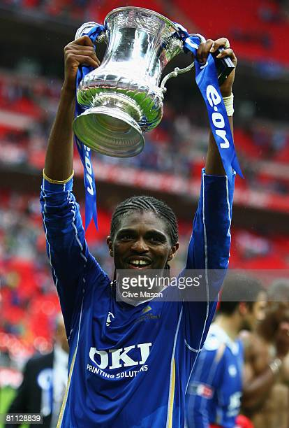 Nwankwo Kanu of Portsmouth celebrates with the trophy following the FA Cup Final sponsored by EON between Portsmouth and Cardiff City at Wembley...
