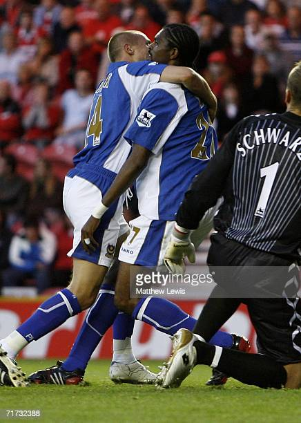 Nwankwo Kanu of Portsmouth is congratulated by team mate Matt Taylor after scoring the opening goal during the Barclays Premiership match between...