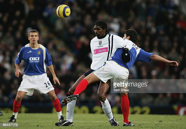 Nwankwo Kanu of West Bromwich Albion holds back Dejan Stefanovic of Portsmouth during the Barclays Premiership match between Portsmouth and West...