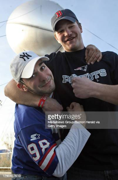 Ny And New England fans at the NFL Experience.Lucas Perito, a Giants fan from NY, and Chris Post, Patriots fan from Bridgewater ,MA, jokingly duke it...