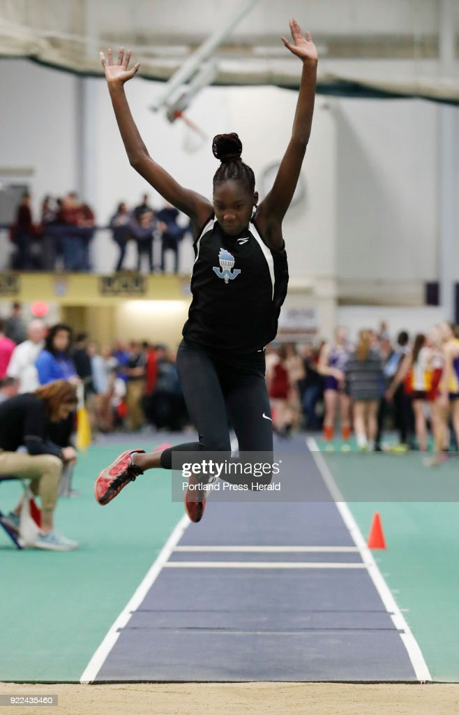 Nyagoa Bayak, of Westbrook, jumps in the triple jump during the Maine Class A Track and Field Championship Monday, Feb. 19, 2018 in Gorham, Maine.