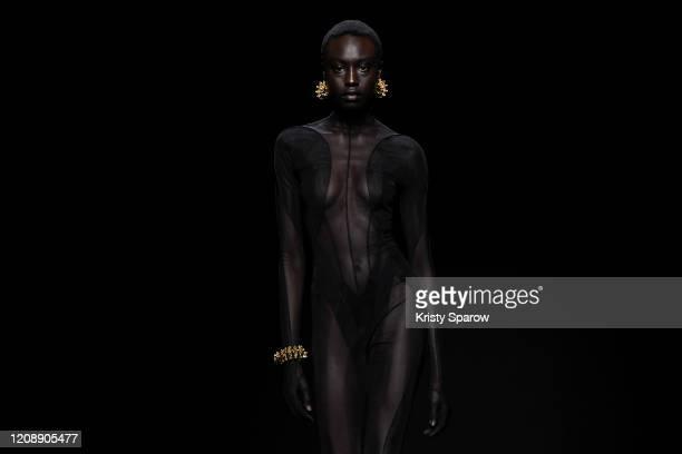 Nyagua Ruea walks the runway during the Mugler show as part of Paris Fashion Week Womenswear Fall/Winter 2020/2021 on February 26, 2020 in Paris,...