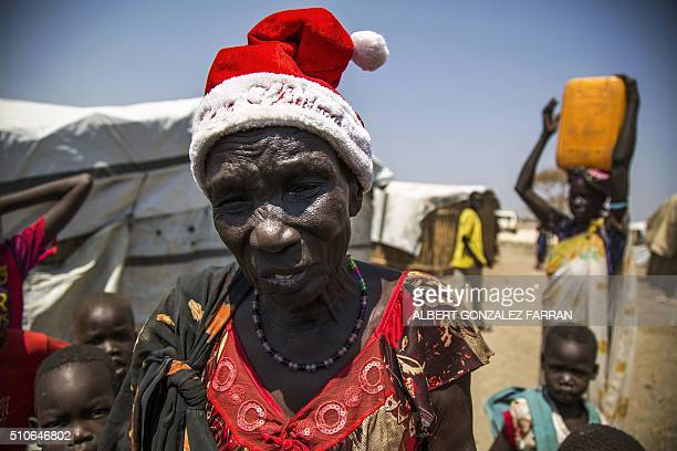 TOPSHOT Nyakier Kuong a displaced woman from Bentiu is pictured at the Protection of Civilians site in Bentiu South Sudan on February 16 2016 Nyakier...