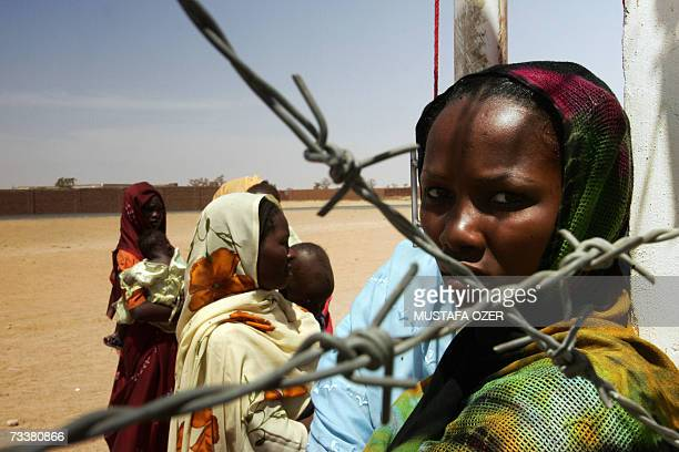 A refugee waits for a medical examination at the Turkish Red Crescent Hospital in the Darfur city of Nyala 20 February 2007 There are some four...