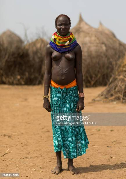 Nyangatom tribe woman with a huge necklace Omo Valley Kangate Ethiopia on June 9 2017 in Kangate Ethiopia