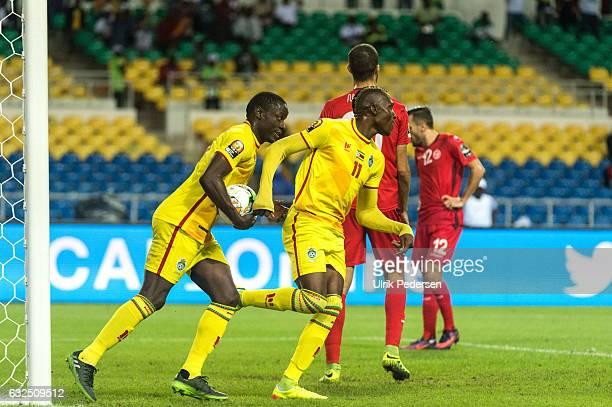 Nyasha Liberty Mushekwi and Tendai Passion Ndoro of Zimbabwe celebrate scoring to make 2-4 during the African Nations Cup match between Zimbabwe and...