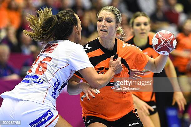 Nycke Groot of Netherlands challenge for the ball during the 22nd IHF Women's Handball World Championship gold medal match between Netherlands and...