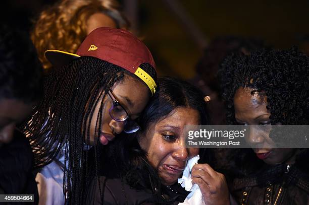 Nyela Williams left to right Barbara Jones and Dawn Perry embrace outside Marion Barry's Southeast DC home as people gathered to remember the life of...